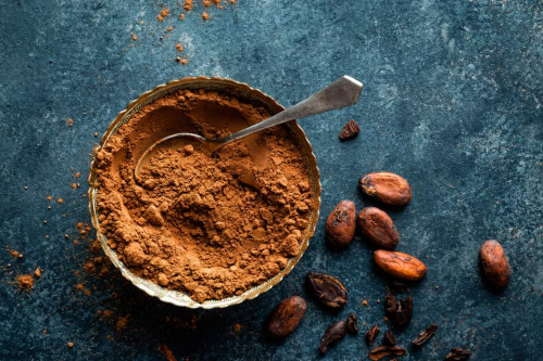 cocoa-powder-and-cacao-beans-on-dark-background--top-view-654544408-5ab44e6304d1cf00361f1b33.jpg